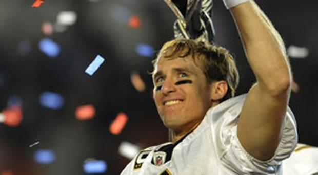 New Orleans Saints quarter-back Drew Brees holds the Vince Lombardi Trophy in Miami on Sunday night Photo: Getty Images