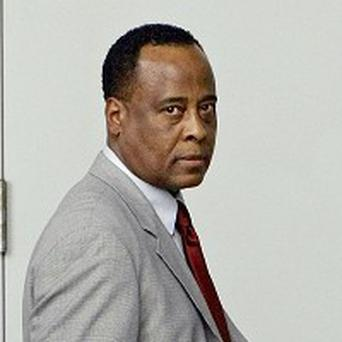 Dr Conrad Murray arrives at court where he was charged over Michael Jackson's death (AP)