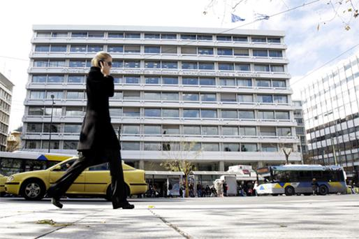 A pedestrian walks past Greece's ministry of finance in Athens, Greece, on Monday. Photo: Bloomberg News