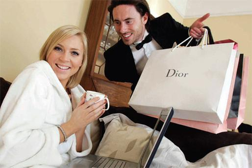 The lap of luxury: Eoin Carroll delivers top Irish model Sarah McGovern's online shopping as a recent survey published by Visa Europe shows that Irish shoppers spend an average of €1,700 each on online purchases of consumer products