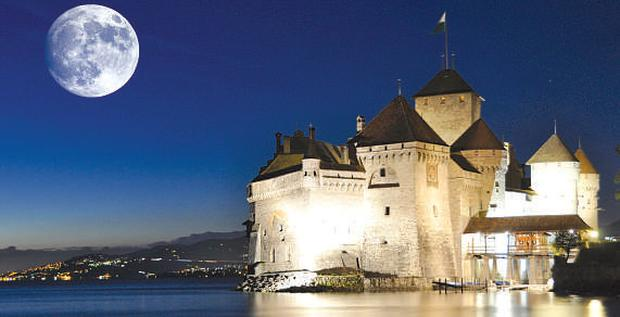 The castle of Chillon sits dramatically between the shores of Lake Geneva and the Alps
