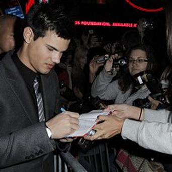 Taylor Lautner meets fans at the premiere of Valentine's Day