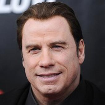 John Travolta liked his hairstyle in From Paris With Love