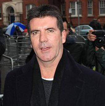Simon Cowell's charity single for Haiti has been selling fast