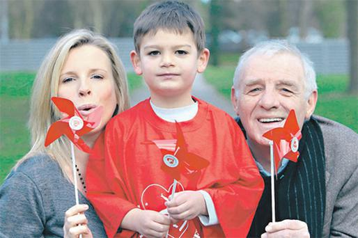 Eamon Dunphy with his daughter Colette and grandson Braiden at the launch of Heart Children Ireland's Windmill Campaign in Dublin yesterday