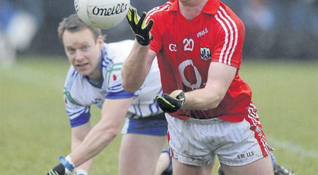Cork's Fintan Gould hand passes the ball durin the NFL game against Monaghan last weekend. Referees are still struggling to judge the legality of passes under the new rules