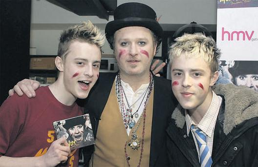 Twins John and Edward Grimes (Jedward) with Mundy last April before they were famous.