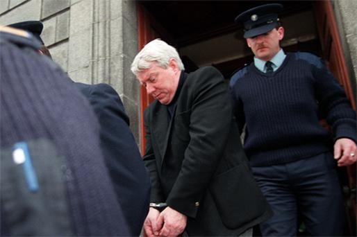 Ivan Payne, the priest who was jailed for six years for abusing Andrew Madden and others, is led away from court