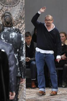 British designer Alexander McQueen acknowledges the audience after his Fall-Winter 2010-2011 Menswear collection on January 18, 2010 during the Men's fashion week in Milan. AFP PHOTO / Damien Meyer (Photo credit should read DAMIEN MEYER/AFP/Getty Images)
