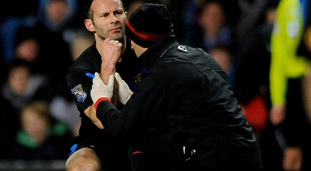 Ryan Giggs being treated by the physio shortly before going off injured. Photo: Getty Images
