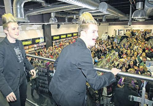 Jedward greet the 400 fans crammed in the HMV store in Dundrum.