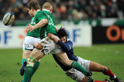 Ireland's captain Brian O'Driscoll is hauled to the ground during yesterday's 33-10 Six Nations defeat to France in Paris. Photo: Getty Images