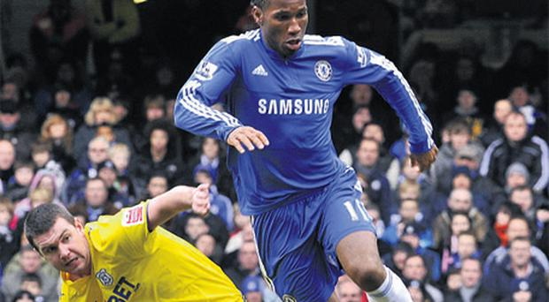 Chelsea's Didier Drogba and Cardiff's Anthony Gerrard battle for possession at Stamford Bridge yesterday