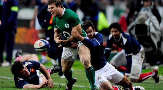 Ireland's Gordon D'Arcy fumbles the ball after being tackled by France's David Marty Photo: Getty Images