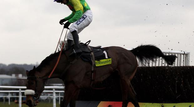 Ruby Walsh displays his rodeo skills to partner Master Minded to victory, despite the horse's error at the final fence, in Saturday's Game Spirit Chase at Newbury Photo: Getty Images