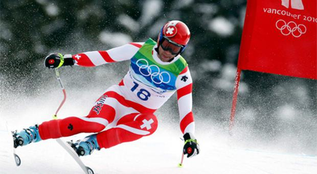 Switzerland's Didier Defago clears a gate on his way to winning gold in the men's alpine skiing downhill event at the Vancouver 2010 Winter Olympics in Whistler