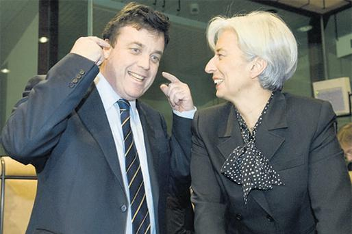 Finance Minister Brian Lenihan moves playfully to block his ears as he speaks with his French counterpart Christine Lagarde yesterday about last weekend's rugby match, during a meeting of Eurogroup finance ministers in Brussels yesterday
