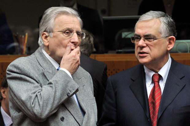 ECB president Jean Claude Trichet and ECB vice president Luca Papademos talk prior to an Economic and Financial Affairs (ECOFIN) ministers meeting at the EU headquarters in Brussels. Photo: Getty Images