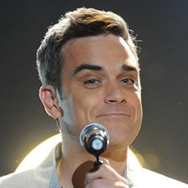 Robbie Williams says Oasis deserve a Brit for Morning Glory