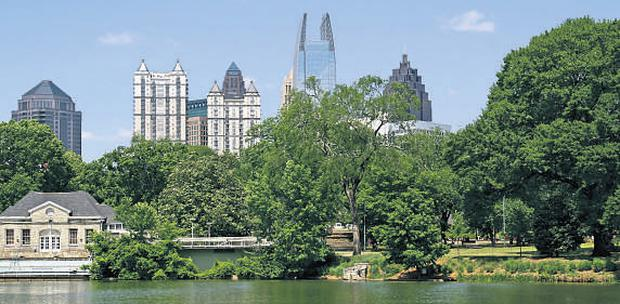 The tall towers of the city's Downtown area loom out from Piedmont Park, referred to by locals as the Central Park of Atlanta