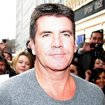 The Simon Cowell-organised charity single for Haiti has topped the charts