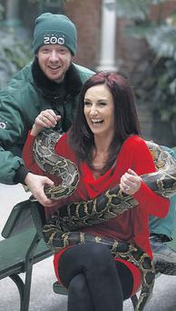 TV presenter Lorraine Keane pictured with zookeeper Brendan Walsh and Monthy the python.