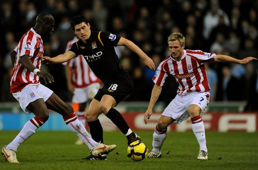 A late equaliser from Gareth Barry (C) rescued City's top four ambitions Photo: Getty Images
