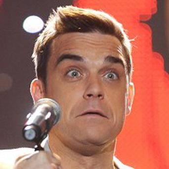 Robbie Williams says he prefers being in a band