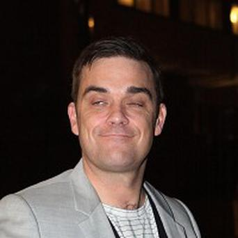 Robbie Williams has enjoyed a surge in record sales