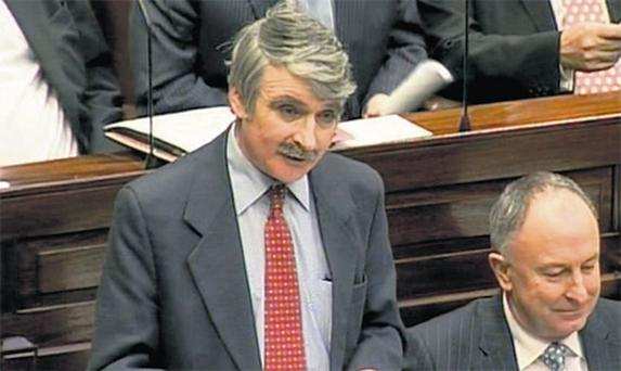 A still from a broadcast of Oireachtas proceedings shows Defence Minister Willie O'Dea addressing the Dail last night