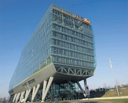 The ING banking and insurance group building in Amsterdam yesterday. The Dutch bancassurer posted a fourth-quarter loss more than double forecasts, casting a shadow over plans to spin off its insurance business and refocus as a leading European retail bank