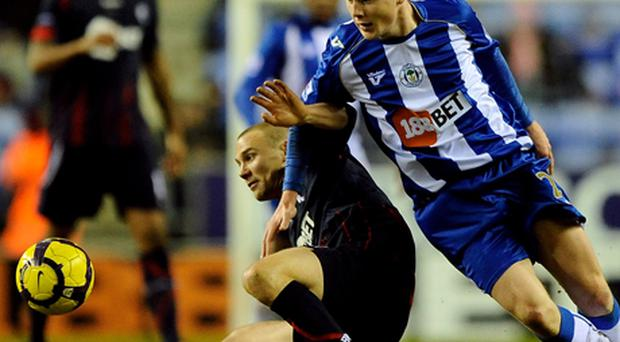 James McCarthy battles with Matthew Taylor during the match between Wigan Athletic and Bolton Wanderers. Photo: Getty Images