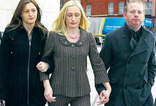 Ruth Dunne (centre) leaving court yesterday with her family and friends