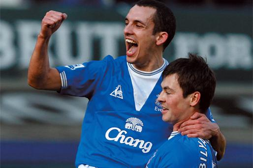 Everton's Diniyar Bilyaletdinov (r) celebrates with Leon Osman after scoring his side's first goal in the 3-1 win over Manchester United at Goodison Park yesterday