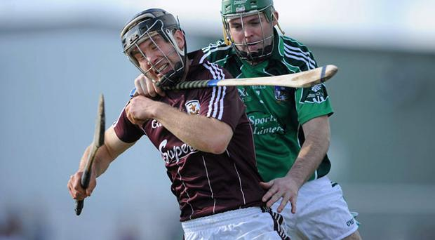 Galway attacker Rory Gantley is reined in by Des Kenny of Limerick at Kilmallock yesterday BRENDAN MORAN/SPORTSFILE