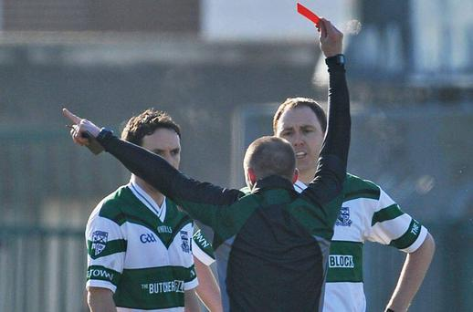 Referee Michael Duffy sends off Brian Mulligan, left, in the first minute of Sunday's All-Ireland club SF semi-final against Kilmurry-Ibrickane