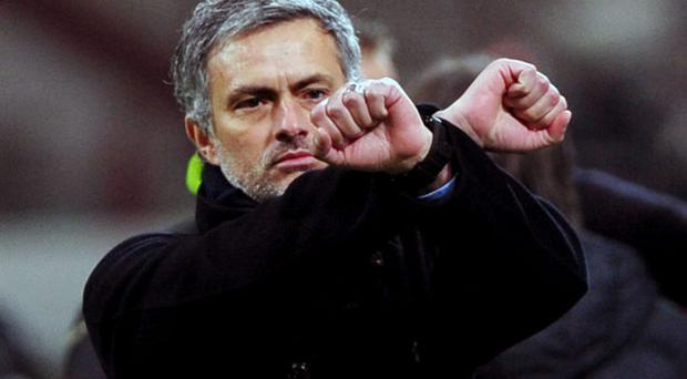 Jose Mourinho, seen here making his 'chains' gesture during Inter Milan's march against Sampdoria last friday, is sure to relish the mind games ahead of tomorrows match against Chelsea Photo: Getty Images