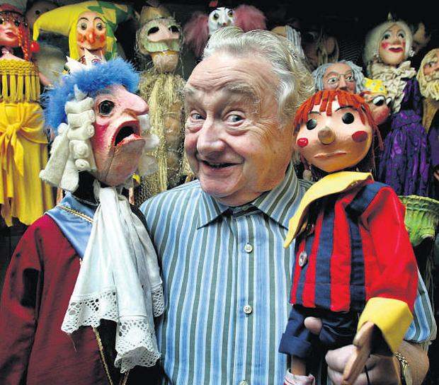 Eugene Lambert with his puppets in his Monkstown theatre in Dublin.