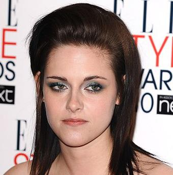 Kristen Stewart says she isn't a pro at awards events