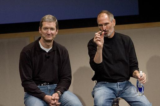 Tim Cook, pictured here with Steve Jobs, said that Apple TV was a 'hobby', and that the company was now focused on mobile devices Photo: Getty Images