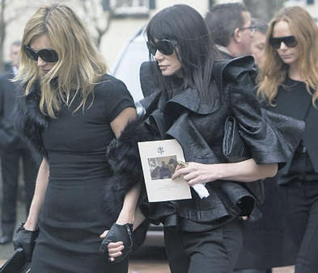 Kate Moss (far left) and Stella McCartney (on right of picture) attended the service.