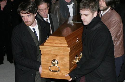 The body of Eugene Lambert arrives at St Patrick's Church in Monkstown for the removal mass. Photo: Collins Photo Agency