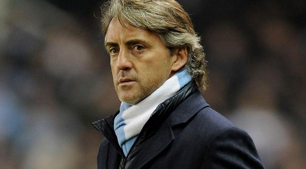 Roberto Mancini has insisted he has no intention of resting Wayne Bridge against Chelsea. Photo: Getty Images