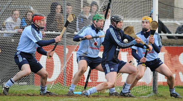 Dublin players, from left, Niall Corcoran, John McCaffrey, Gary Maguire and Oisin Gough prevent a goal-bound Tipperary free during their NHL Division 1 clash at Parnell Park STEPHEN MCMAHON / SPORTSFILE