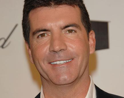 Simon Cowell had to hold back his tears as he re-lived the moment he heard of his father Eric's death a decade ago.