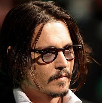Johnny Depp attended the premiere of Alice In Wonderland