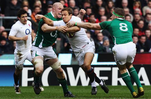 The Irish tackle count on Saturday was huge, as epitomised here by Paul O'Connell and Jamie Heaslip on Jonny Wilkinson Photo: Getty Images
