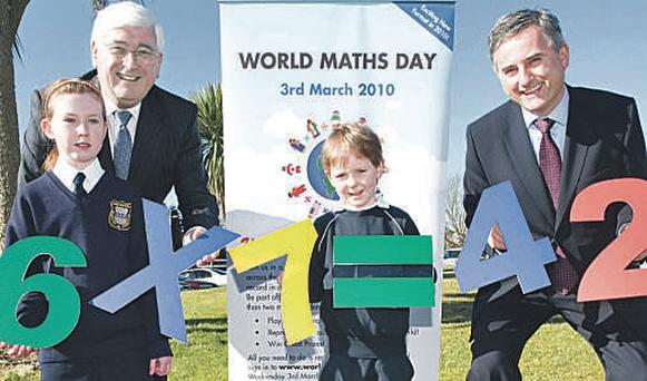 Education Minister Batt O'Keeffe with Eimear McMahon (10), Emmet Davern (6) and CJ Fallonwill CEO Brian Gilsenan at the launch of World Maths Day at St Fanahan's College and Bunscoil na Tirbhirte, Mitchelstown, Co. Cork