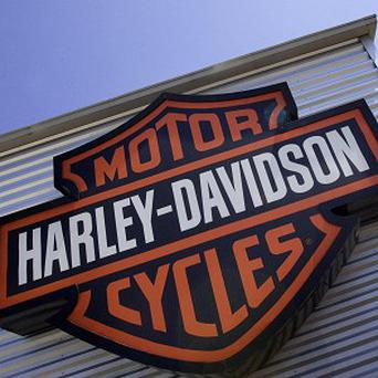 A US stuntman has twice broken the world record for the longest distance jumped on a Harley-Davidson. (AP)