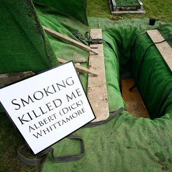 Anti-smoking signs were placed around the coffin of Albert 'Dick' Whittamore